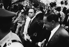 Marlon Brando, James Baldwin and Joseph Mankiewicz marching to the rally. August 28, 1963.