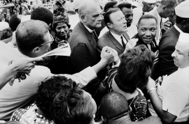 """An enthusiastic """"brotherhood"""" hand clasp after the """"I HAVE A DREAM"""" speech - Mahalia Jackson, Dr. Eugene Carson Blake and Walter P Reuther, UAW. Lincoln Memorial, August 28, 1963."""