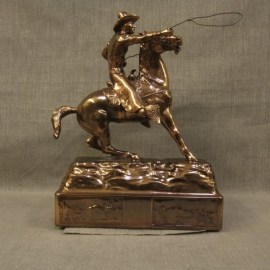 """Cowboy Throwing Lariat Copper Statue, $1,800.00. This is an extremely rare copper patina statue, it is """"mint condition, warehouse new,"""" made in the 1940s by Owens Company that produced high end novelties and accessories for home and office. They produced numerous subjects, including a distinctive line of Western subjects. The Owens Company is the maker of the famous Oscars for the movie industry. I purchased the remaining warehouse inventory, which had been setting in inventory over fifty years. This is the last of a series of Western statues. I will be adding a few other different pieces over time. Inquires at Collier Gallery. Size: 13.5"""" High 9.5"""" Long 6"""" Wide Very Heavy"""